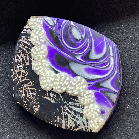 purple brooche